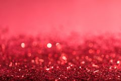 Christmas background with red shiny confetti. With bokeh stock images