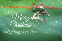 Christmas background with red silk traditional ribbon, white deer, evergreen tree and jingle bells. Stock Image