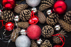 Christmas background with red silver balls and pinecone. Stock Photo