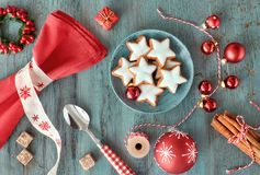 Christmas background in red and white on rustic turquoise wood. Top view on Christmas cookies, spices and decorations Stock Photography