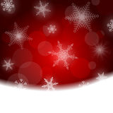 Christmas background - red with white snowflakes Royalty Free Stock Images