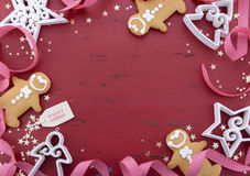 Christmas background on red wood table. Stock Photos