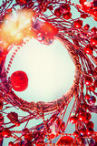Christmas background with red wreath royalty free stock photography