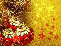 Christmas background with red and yellow ornament on a golden glitter background. stock illustration