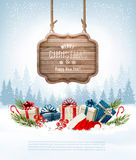 Christmas background with a retro wooden sign and gift boxes. Ve Stock Photos