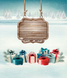 Christmas background with a retro wooden sign Stock Photos