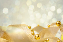 Christmas background with ribbon and beads. Christmas seasonal background with ribbon and golden beads Stock Photography