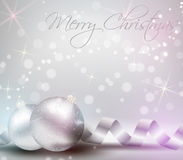 Christmas background with ribbons and shiny christmas baubles Royalty Free Stock Image