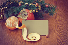 Christmas background with ripe persimmons and tangerine Stock Photography