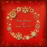 Christmas background with round frame of golden snowflakes Stock Images