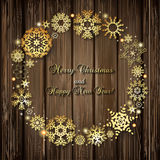 Christmas background with round frame of golden snowflakes and l Royalty Free Stock Image