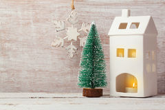 Christmas background with rustic decorations, house candle and pine tree Royalty Free Stock Images