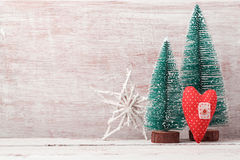 Christmas background with rustic decorations, pine tree and heart shape Stock Image