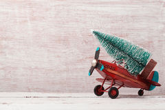 Christmas background with rustic vintage airplane toy and pine tree Royalty Free Stock Images