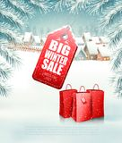 Christmas background with a sale tag and a shopping bags. Vector Stock Photography
