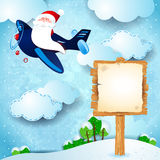 Christmas background with Santa, airplane and sign Stock Photography