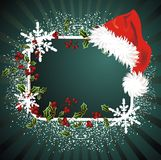 Christmas  background with Santa Claus cap. Christmas frame with Santa Claus cap and holly Stock Images