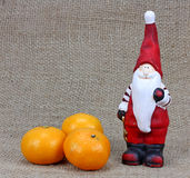 Christmas background with Santa Claus and tangerines. Stock Photos