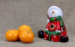 Christmas background with Santa Claus and tangerines Royalty Free Stock Images