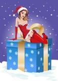 Christmas background. Sexy santa girl sitting on Stock Photo