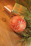 Christmas background. Shining ball, handmade gift boxes and pine branch Royalty Free Stock Image