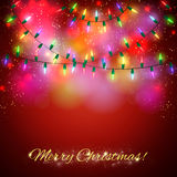 Christmas background with shining colorful lights Stock Images