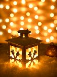 Christmas background with shining lantern Stock Images