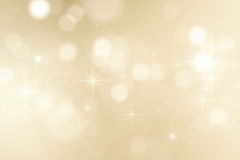 Christmas background with shining sparkles. Abstract bright golden sparkles background Royalty Free Stock Photos