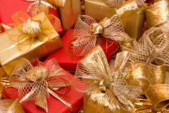 Christmas background. Shiny gifts. Stock Photos