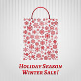 Christmas background with a shopping bag from snowflakes Stock Image