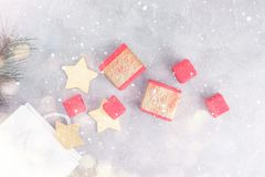 Christmas background: shopping bags, gift boxes and gold stars under snow Stock Images