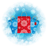 Christmas background with a shopping bags. Christmas hopping bags from white snowflakes Stock Photo