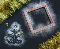 Christmas background - silhouette of fir tree, frame, tinsel, co Stock Photos