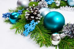 Christmas background with silver, blue and turquoise baubles royalty free stock photography