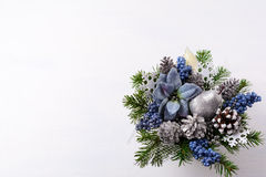 Christmas background with silver glitter decor and blue silk poi Royalty Free Stock Image