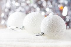Christmas background with silver christmas ornaments, soft focus. stock photo