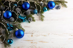 Christmas background with silver pinecone and blue ornaments Royalty Free Stock Photography