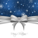 Christmas background with silver ribbon, snowflakes and glitter, design for your greeting card Royalty Free Stock Photo