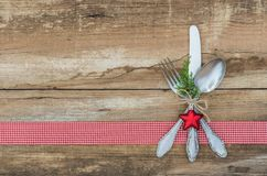 Christmas background with silverware place setting for festive holiday dinner. Christmas table place setting with rustic cutlery decoration royalty free stock photography