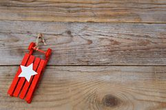 Christmas background - sleigh on wood Royalty Free Stock Images