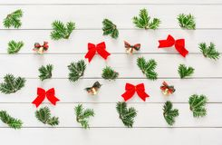 Christmas background with small balls and green branches on wood Stock Image