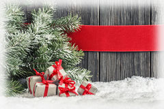 Christmas background with small gifts Royalty Free Stock Images