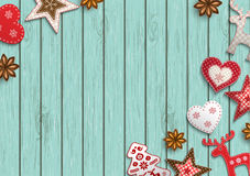 Christmas background, small scandinavian styled decorations lying on blue wooden backdrop, illustration. Christmas background, small scandinavian styled red stock illustration