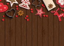 Christmas background, small scandinavian styled decorations lying on brown wooden backdrop, illustration Stock Photos