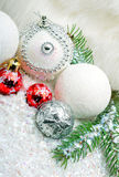 Christmas background with snow, christmas baubles, pine twigs Royalty Free Stock Photos