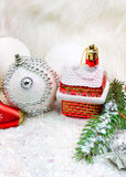 Christmas background with snow, christmas baubles, pine twigs Stock Photos