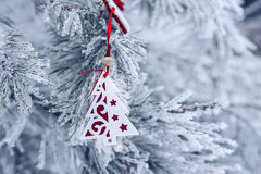 Christmas background with snow-covered Christmas tree and Christmas toy Stock Photo
