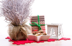 Christmas background with snow covered tree, candle holder, xmas present Stock Photo