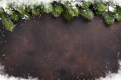 Christmas background with snow fir tree Royalty Free Stock Images