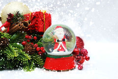 Christmas background with snow globe Stock Images